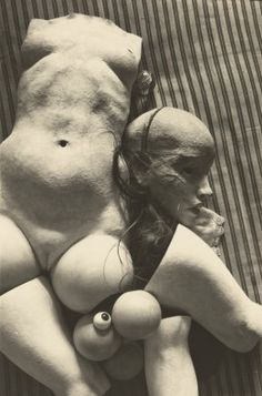 In 1933, Hans Bellmer, a German artist working in Berlin with a flair for Surrealism, began building and photographing a near life-size doll of a young girl. In the photographs, Bellmer presented this doll, designed to be dismantled and rebuilt, in varying states of undone, displaying her component parts parsed, the legs, arms, hands, torso, and head all neatly arranged on a palate, or else jumbled together with gauzes, artificial roses, and streams of lace.