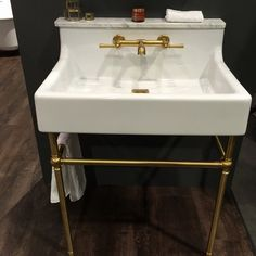 The DXV American Standard Oak Hill Console Sink is charming, elegant and pairs well with brass colored fixtures and legs. Consoles, Bathroom Renovation Cost, Console Sink, Kitchen And Bath Design, Bathroom Colors, Bathroom Ideas, Bathroom Trends, Vanity Sink, Layout