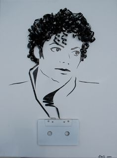 portrait of a michael jackson  made out of recycled cassette tape with original cassette