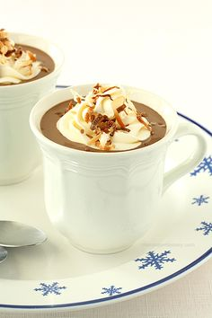 Toasted Coconut Hot Chocolate made with coconut milk then topped with marshmallow whipped cream and toasted coconut