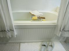 Use beadboard and trim to update a boring builder bathtub. Great for the guest bath!