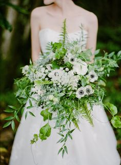 Anemone and greenery wedding bouquet: Photography: Aria Studios - http://www.ariastudios.com/