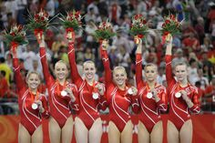 U.S. women's team members, from left: Shawn Johnson, Nastia Liukin, Chellsie Memmel, Samantha Peszek, Alicia Sacramone, and Bridget Sloan pose with their silver medals after the women's team final competition at the Beijing 2008 Olympics  in Beijing, Wednesday, Aug  13, 2008. (AP Photo/Amy Sancetta) Beijing Olympics Gymnastics Womens Team