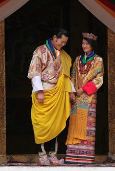King Khesar Namgyel Wangchuck with his wife and queen Jetsun Pema pose for the media after their wedding ceremony