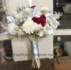 Natural bouquet in silver, creamy white, deep red burgundy, and ice blue with gem accents. No alterations available. Flowers include: soft preserved real rose, seeded eucalyptus, wood sola, lavender,