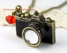 vintage style black camera necklace with red crystal by Sevinoma, $4.99