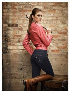 Ava Full Seat Ready for a fresh new take on the classic breech? Look no further than our full seat Ava riding jean. It all starts with a more flattering cut and hand-distressed, stretchy indigo denim. Traditional five-pocket jean styling is brought to life by brilliant fushia stitching, which provides the perfect outline for the heavily embroidered and embellished back pockets. Wherever you go, people will notice.