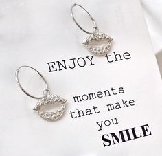 ENJOY THE MOMENTS THAT MAKE YOU SMILE SILVER EARRINGS WITH A SMILE
