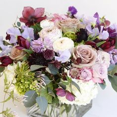 Delicious textures and plum tones in this mixed arrangement of roses, ranunculus, hyacinth, sweet pea, tulips, and hydrangea | LILLA BELLO