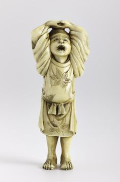 Netsuke of carved ivory, a man with hands interlocked above head, unsigned: Japan