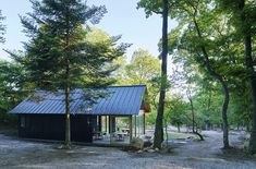 japanese design studio mori no terrace has created a camping café called 'terrace of the forest' using locally sourced material in osaka, japan. Japan Design, Gable House, Terrace Design, Building Structure, Campsite, Black House, Interior And Exterior, Cottage, House Design