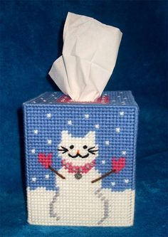 If you love snowmen and you love cats... This is a perfect combination for you.  This Snowman Cat Tissue box cover fits over any boutique tissues.  It