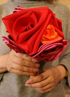 Create beautiful and simple ribbon or fabric flowers in a few steps. Make a bunch, and have lovely flowers that bloom on and on! These lovely flowers are a perfect Valentine's Day gift.