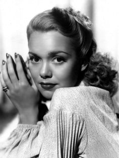 """Jane Wyman as Alice Cullman.  """"Alice Cullman blossomed as softly as the first light of dawn and as beautifully as a flower.  It seemed that she was a girl one day and a woman the next.  Her blond hair tumbled below her shoulders in a glory of curls and waves, and her doe-like eyes were blue and dreamy.  She was loving, understanding, and sweet, and her heart was dear and tender.""""  Walk a Mile With Me."""
