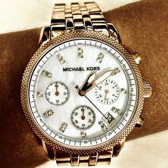 I love my Michael Kors pink gold watch with swarovski elements