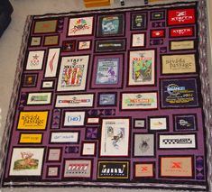 I love how the purple is used in the block borders for this t-shirt quilt