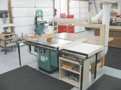 Cabinet underneath extension table holds table saw accessories, tools and blades.