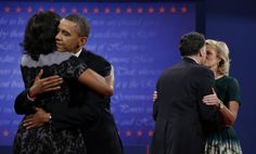 President Barack Obama, left, hugs his wife Michelle while Republican presidential nominee Mitt Romney kisses his wife Ann following the third presidential debate at Lynn University, in Boca Raton, Florida, October 22, 2012. (AP)