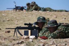 A member of China's People's Liberation Army (PLA) special forces participates in a comprehensive military contest at a PLA training base in north China's Inner Mongolia Autonomous Region, July 23, 2013.