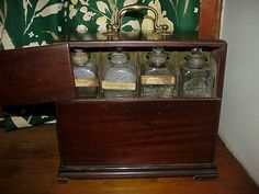 Hidden compartment where poisons are stored for safe keeping - Tam's Apothecary cabinet. DEADLY AFFAIR