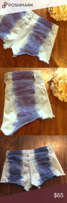 """•Tory Burch• Tie Dye Jean Shorts Tory Burch Tie Dye Jean Shorts in Great Used Condition. Dark Blue Tie Dye Stripes down the front and back, Tory Emblem on the front Button and back pocket. In Great Condition but these do show some signs of wear, see pictures, these shorts have a naturally distressed look to begin with so it doesn't take away from the look! Waist Measures Approximately 15"""", Hips 17"""", Inseam 2.5"""" Tory Burch Shorts Jean Shorts"""