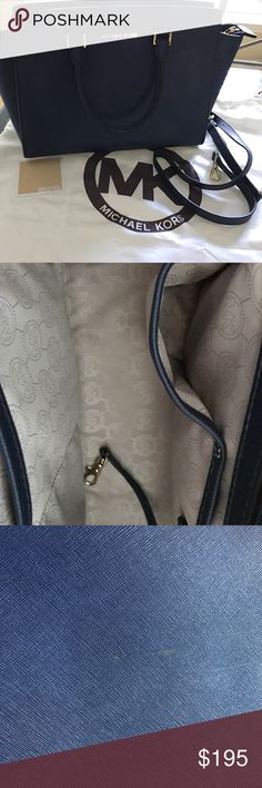 MIchael Kors Selma Satchel - Navy Excellent condition, near perfect exterior (picture shown of one small mark on backside of handbag), clean inside / bottom. Used *maybe* 3x. Firm price due to condition of bag. Michael Kors Bags Satchels