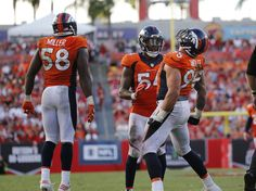 Oct 2, 2016; Tampa, FL, USA; Denver Broncos defensive end Derek Wolfe (95) celebrates with inside linebacker Brandon Marshall (54) and outside linebacker Von Miller (58) after he sacked Tampa Bay Buccaneers quarterback Jameis Winston (3) (not pictured) during the second half at Raymond James Stadium.  (3735×2786)