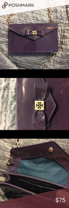 Tory Burch small clutch purse Purple glossy Tory Burch clutch purse. Has a detachable gold chain crossbody strap. Has 3 card pockets inside. Barely worn. In great condition Tory Burch Bags Clutches & Wristlets