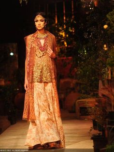 A model walks the ramp for designer Sabyasachi on Day 1 of Delhi Couture Week, held in New Delhi, on July 31, 2013.