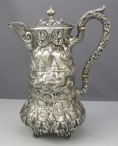 Schofield Co. sterling silver chocolate pot in the Landscape, or Architectural, pattern, featuring a castle motif, circa Britannia Silver