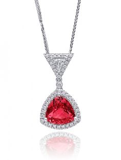 This gorgeous pendant features a 3.03CT unheated pink spinel, and a trillion cut diamond, all surrounded by sparkling diamond halos. Set in 18K white gold (PSK10000-SPIN). #coastdiamond