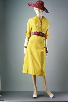 Summer day dress    Place of origin:  Paris, France (made)    Date:  1949 (made)    Artist/Maker:  Jacques Fath, born 1912 - died 1954 (designer)    Materials and Techniques:  Printed plain weave cotton, with padded shoulders