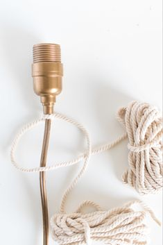 Make a simple, unique macrame wrapped wall light with a twisted cord in no time for a statement-making piece of decor. Diy Pendant Light, Pendant Light Fixtures, Diy Light, Mini Pendant, Pendant Lamp, Swag Light, Light Art, Pendant Lights, Industrial Light Fixtures