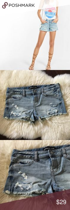 Express Low Rise Distressed Denim Cutoff Shorts 8 Faded denim with an abundantly frayed hem will make this leggy look an instant warm weather favorite. The low rise adds to its casual vibe. Pair these shorts with an Express One Eleven graphic tank and wedges for chic and easy weekend style.  * Low rise * One-button closure with zip fly, five-pocket styling * Fading and heavy distressing * Curved and frayed hem * Cotton/Spandex  New with tags Size 8 98% Cotton & 2% Spandex  Approx…