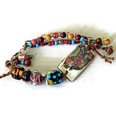 Southwestern bracelet, Rustic Boho bracelet with Lampwork and Ceramic,... ($56) ❤ liked on Polyvore featuring jewelry, bracelets, bohemian jewellery, boho style jewelry, gypsy jewelry, bohemian bangles and ceramic jewelry