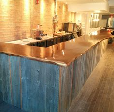 Throwback to a few years ago when this walnut live-edge bar was installed at and got it's first coat of penetrating epoxy. Live Edge Bar, Communal Table, Walnut Slab, Commercial Interiors, Cladding, Epoxy, Outdoor Living, Basement, Custom Design