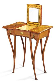 A LOUIS MAJORELLE MARQUETRY DRESSING TABLE CIRCA 1900 Shaped top inlaid with daises, central panel opens to show mirror and birds-eye-maple interior, two short drawers, on shaped supports, signed in marquetry 'Majorelle' 29¾ in. (75.5 cm.) high; 26¾ (68 cm.) wide; 16½ in. (42 cm.) deep