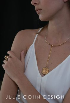 Bronze jewelry by Juile Cohn Design. Vortex necklace with ring stacks.