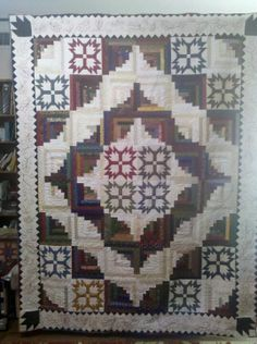 Made and quilted by Kathy Bradbury. Border is embroidered on the longarm..