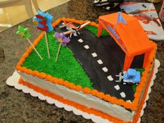 Disney Planes cake. Couldn't find a store that had these yet so I made my own. Used a pit row gift pack. I'm not a cake decorator so there are lots of imperfections but it tasted great and the birthday boy loved it. Update: Planes Fire and Rescue cake pinned under Parties