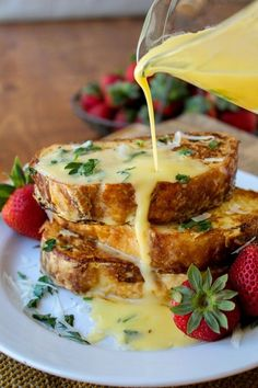 """SAVORY PARMESAN FRENCH TOAST & HOLLANDAISE  ~  4 large eggs...1/2 c. whole milk...1/2 c. heavy cream...1/2 c. grated Parmesan...1/2 t. dry mustard powder...1/2 t. hot sauce (like Tabasco)...freshly ground black pepper, to taste...1 large clove garlic, crushed...dash salt...med. loaf good-quality bread, cut 1"""" thick...butter for frying...flat-leaf parsley or chives for garnish  -  HOLLANDAISE  -  3 egg yolks...1/4 t. Dijon mustard...1 T. lemon juice...dash hot sauce...1/2 c. butter"""