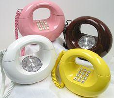 1970's style. Pink phone, yellow phone, white phone, brown phone.