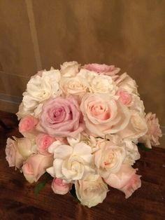 gardenias, roses and hydrangea are brought together for a very fragrant bouquet
