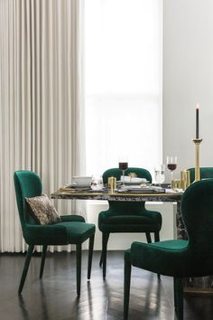 With golden accessories and Art Deco inspired dinnerware, the new Golden Age trend from A by Amara comes to life in the dining room. Perfect if you're looking for Art Deco dining room ideas.