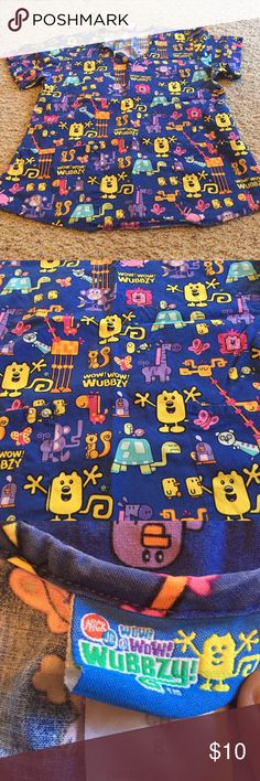 Nick Jr wow wow wubbzy scrub top Very comfortable. Great condition. Just bought some new scrubs and need to make room in my closet. Nickelodeon Tops