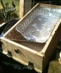 Making our first Solar Wax Melter,