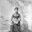 African American woman standing holding fan in close fitting buttoned shirtwaist and gathered skirt. c.1890 For more on African American experience and achievements in the U.S. and elsewhere, visit Discover Black Heritage, a travel guide to black history and culture. Found On Flicker.com in Black Hi...Flash Black Photo: African American Woman, Late 19th Century