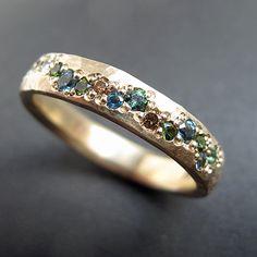 Eternity ring by Sally Grant. Topaz, cognac diamonds and tourmalines. www.sallygrant.co.uk
