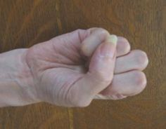 Photo gallery of various Buddhist hand gestures (mudras) used in yoga practice, meditation, and for healing purposes.: Mushti Mudra