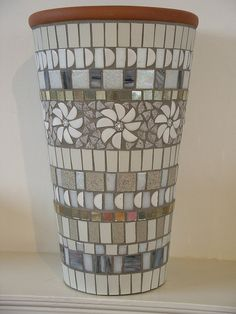 White and grey mosaic pot made with vitreous glass tiles, ceramic tiles, millefiori and silver mirror Más Mosaic Planters, Mosaic Garden Art, Mosaic Tile Art, Mosaic Vase, Mosaic Flower Pots, Mosaic Artwork, Mirror Mosaic, Mosaic Crafts, Mosaic Projects